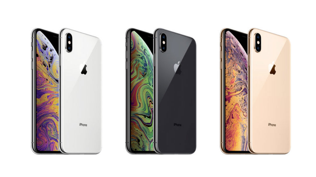 Tech Gifts 2018: Three iPhones Xs showing white, black, and gold back.